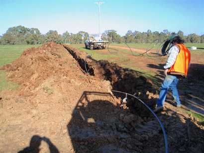 Trench used to carry the power supply cable and permeate tubing to the main control station and production bore at the Glenkara trial site, Victoria