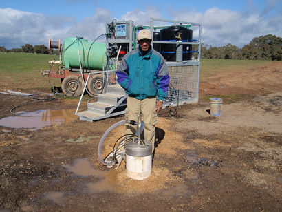 Selva Marimuthu, Desaln8's Principal Hydrogeologist and the skid-mounted remote monitoring and control unit at the Glenkara trial site, Victoria